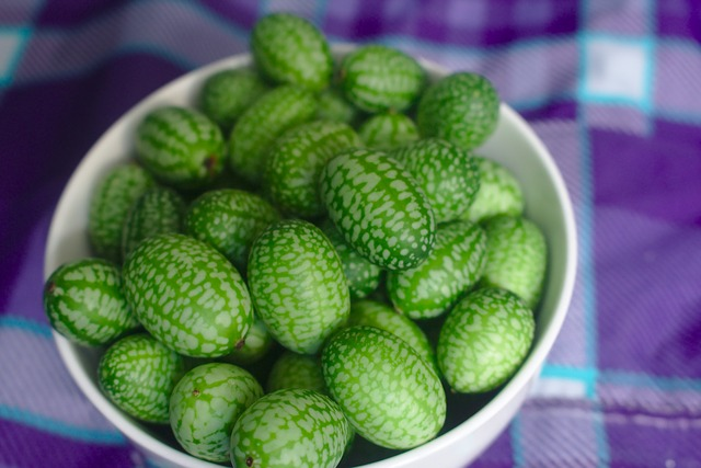 Green-striped cucamelons in a bowl