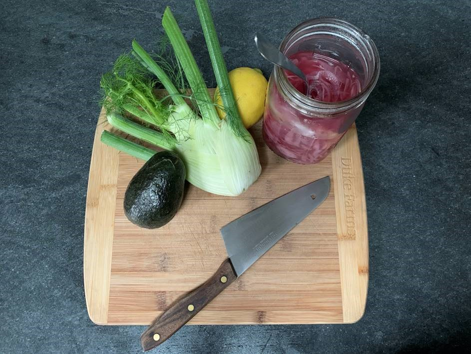 Ingredients for salad on a cutting board