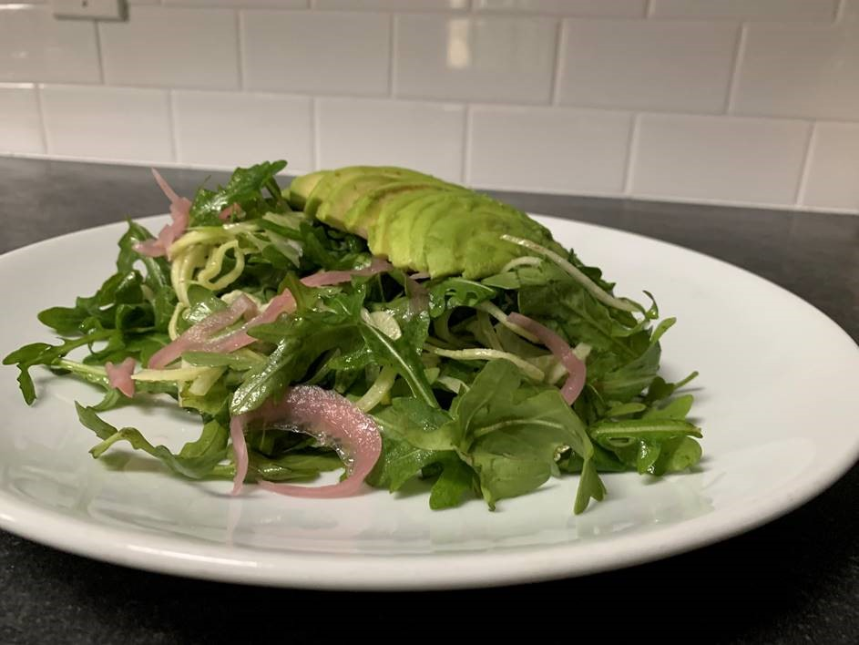 Finished avocado fennel salad, topped with pickled onions and avocado