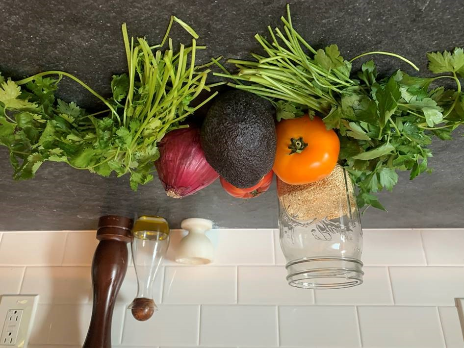 Ingredients for summer quinoa salad on a cutting board