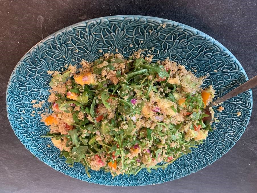 Finished summer quinoa salad on a blue plate